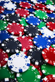 Colorful casino chips background — Stock Photo