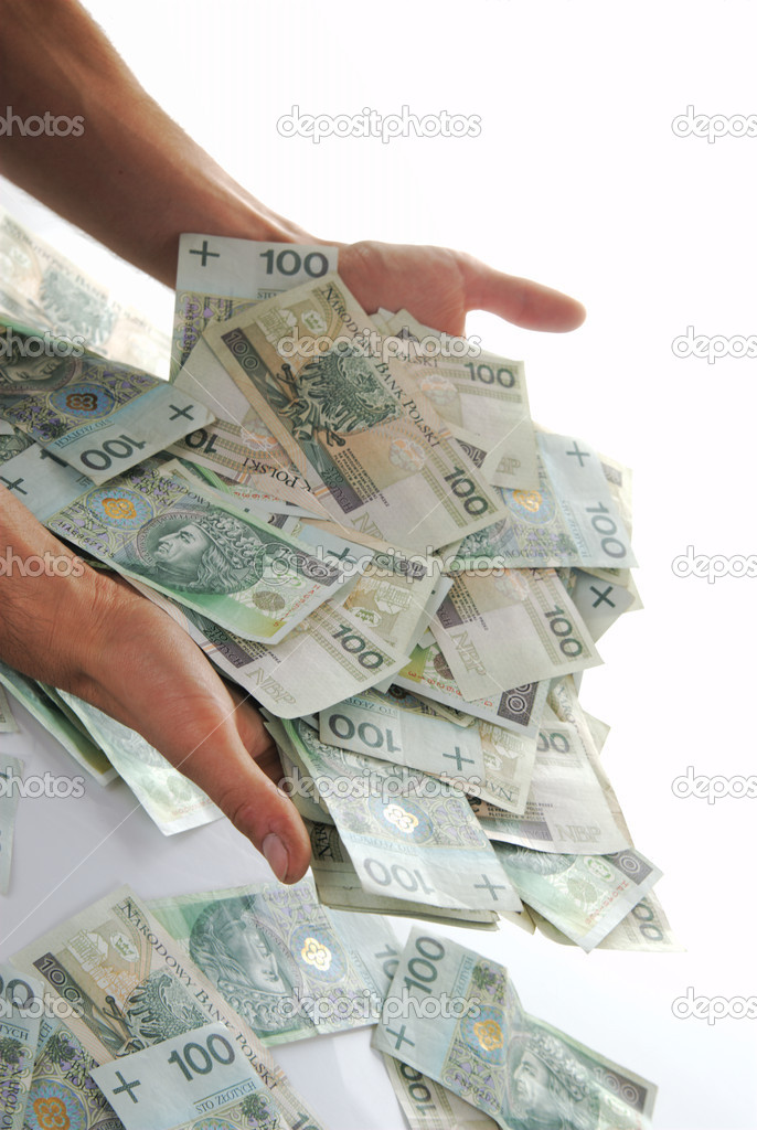Greedy hand grabs money lot of polish banknotes — Stock Photo #1630316