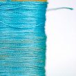 Stock Photo: Spool of thread macro texture