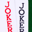 Jokers on green — Stock Photo