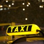 German yellow taxi sign night — Stock Photo