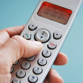 Hand dialing the phone — Stock Photo