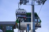 Skiing in ski lift — Stock Photo