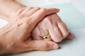 Old and young hand — Stock Photo