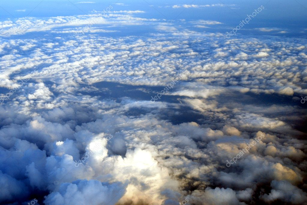 View from an aircraft on beautiful clouds in the evening sunlight — Stock Photo #1639337