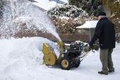 Senior man with snowblower — Stock Photo