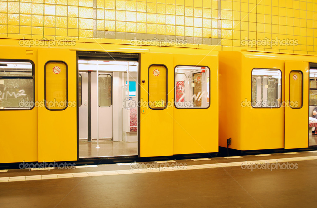 Orange berlin metro train in a yellow station — Stock Photo #2381079