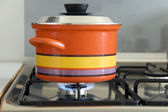 Saucepan on stove — Stock Photo