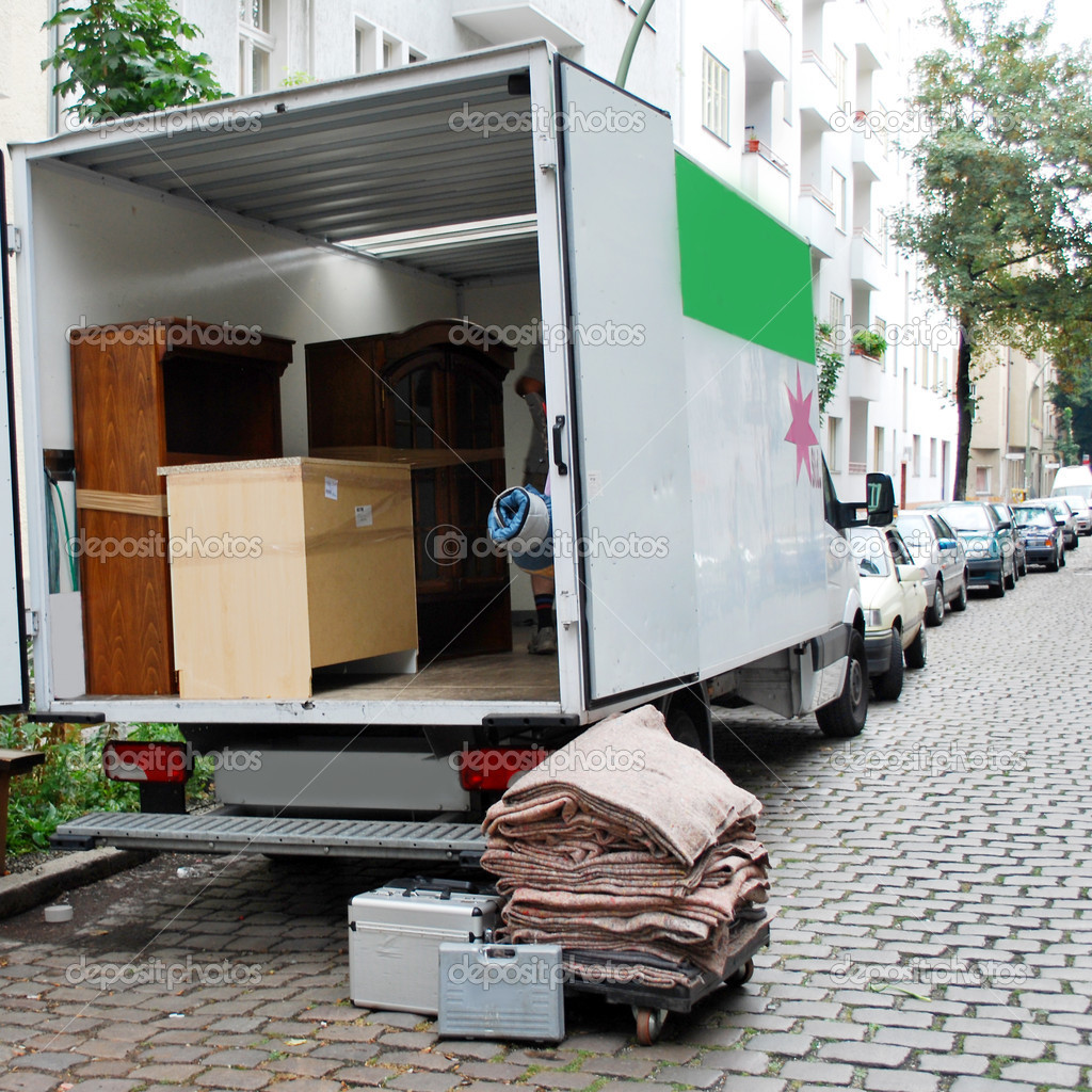 Moving van with boxes and furniture — Stock Photo #2632489