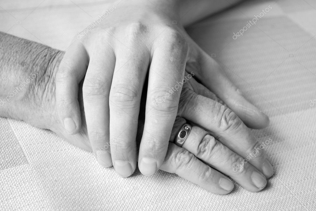 Caring hand of a nurse and a senior patient — Stock Photo #2682119