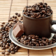Stock Photo: Cup with coffe beans