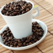 Cup with coffe beans — Stock Photo #1631742