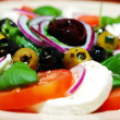 Caprese salad with olives — Stock Photo #1632653