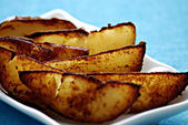 Potatoe wedges — Stock Photo