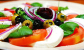 Caprese salad with olives — Stock Photo