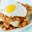 Stock Photo: Beans and egg on toast