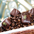 Coffee beans with chocolates — Stock Photo