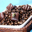 Coffee beans with chocolates — Stock Photo #1642425
