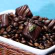 Coffee beans with chocolates — Stock Photo #1642470