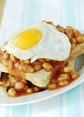 Beans and egg on toast — Stock Photo