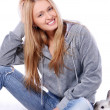 Happy smiling young girl in room — Stock Photo #2390970