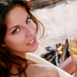 Beautiful young woman drinking wine — Stock Photo #2593033