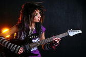 Emo girl with electric guitar — Stockfoto