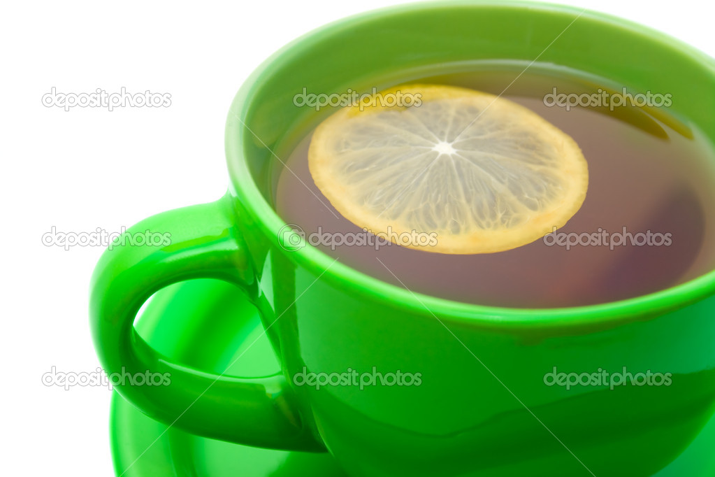 Lemon tea in green cup.  Stock Photo #1621296