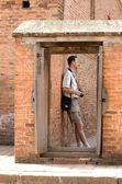 Person over doorway. — Stock Photo