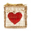 Red heart in a golden gift box — Stock Photo