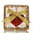 Red heart in a golden gift box — Stock Photo #1780557