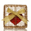 Red heart in a golden gift box - Stock Photo