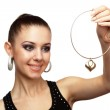 Attractive woman with golden necklace — Stock Photo