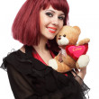 Happy girl with Teddy bear in her hands — Stock Photo