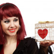 Happy girl with heart in a gift box — Stock Photo