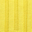 Yellow knitted fabric texture — Foto de Stock