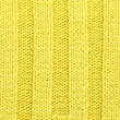 Yellow knitted fabric texture — Stock Photo