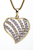 Golden heart shaped necklace — Stock Photo
