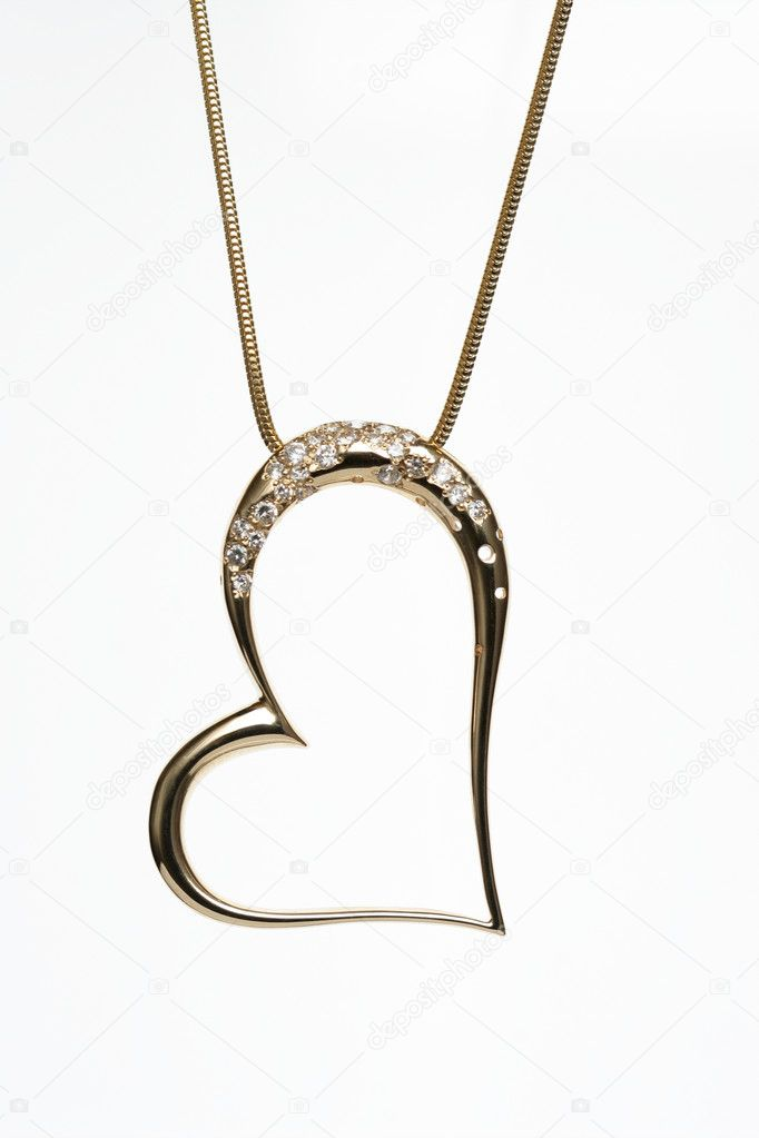 Golden heart shaped necklace on white background — Stock Photo #1789272