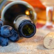 Empty bottle, cork, grapes. — Stock Photo