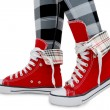 Stock Photo: Red sneakers, checkered leggings.
