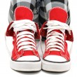 Stock Photo: Red sneakers over white.