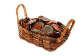 Basket filled with US coins. — Stock Photo