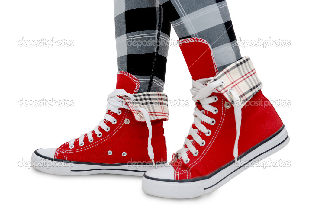 Red sneakers, checkered leggings. Isolated over white. — Stock Photo #1645032