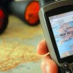GPS-receiver, binoculars, map. — Stock Photo