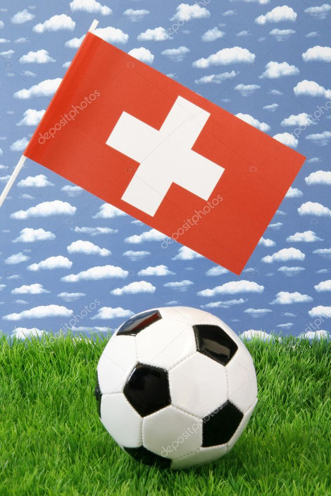 Soccerball on grass with swiss national flag over sky background — Stock Photo #1646388