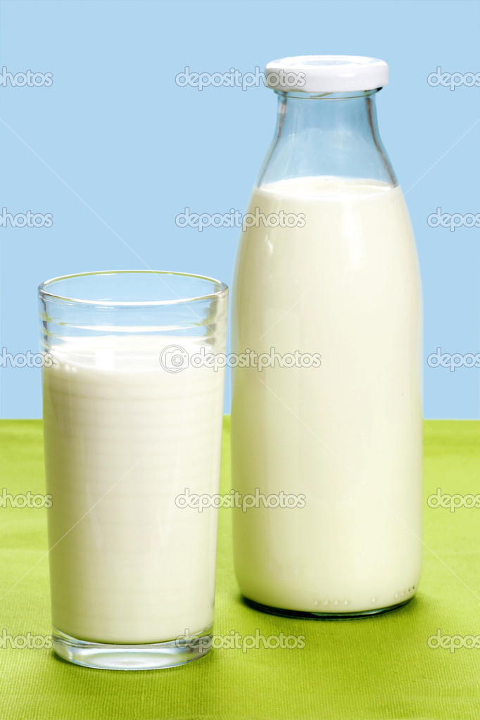 Glass of milk and milkbottle over blue background  Stock Photo #1647139