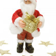 Santa Claus with Golden Gift - Stock Photo