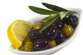 Olives with lemon — Stock Photo