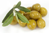 Green olives with olive branch — Stock Photo